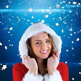 Composite image of sexy santa girl smiling at camera