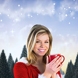Composite image of pretty santa girl holding mug