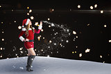 Composite image of sexy santa girl looking up