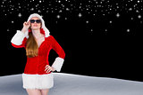 Composite image of cool santa girl wearing sunglasses