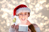 Composite image of sexy girl in santa costume opening a gift