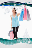Composite image of portrait of a happy woman showing shopping bags