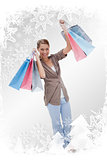 Composite image of happy woman with her shopping bags