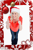 Composite image of fairhaired woman putting her thumbs up while wearing christmas clothes