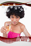 Composite image of young woman holding a glass of champagne while looking at the camera