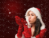 Composite image of pretty brunette in santa outfit blowing over hands