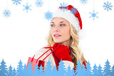 Composite image of festive blonde holding shopping bags