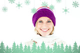 Composite image of beautiful young woman with cap in the winter smiling at the camera