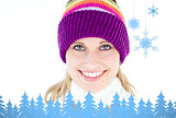 Composite image of glowing young woman wearing white pullover and colorful hat