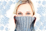 Composite image of delighted woman wearing a poloneck-sweater smiling at the camera