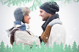 Composite image of attractive young couple in warm clothes hugging