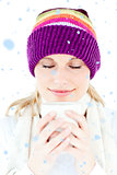 Composite image of delighted woman with a colorful hat and a cup in her hands