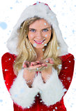 Composite image of pretty girl in santa outfit with hands out