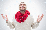 Composite image of attractive young man in warm clothes with hands up