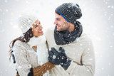 Composite image of attractive young couple in warm clothes