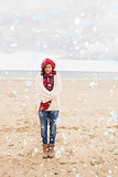 Composite image of pretty woman in stylish warm clothing at beach