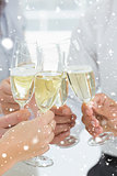 Composite image of hands toasting with champagne