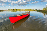 red canoe on a calm lake