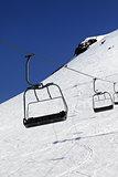 Chair-lift in ski resort at sun day
