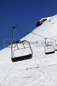 Chair-lift in ski resort at sun day