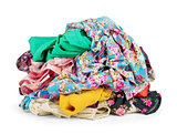 Big heap of colorful clothes,  isolated on white background.