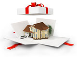 Opened gift with house on the white background.