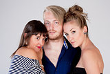 Two Young Female Friends Embracing a Man -