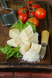 fresh tasty hard parmesan cheese on a wooden board