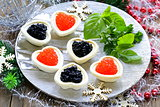 Festive Christmas appetizer tartlets with red and black caviar