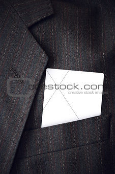 Blank business card in corporate suit pocket