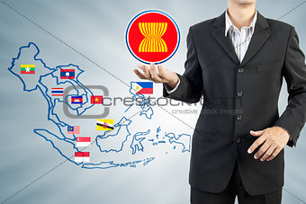 ASEAN Economic Community in businessman hand