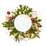 White Christmas plate with baubles, stars and fir -  isolated