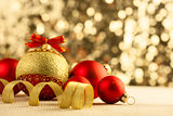 Christmas Bright red baubles with golden ribbons
