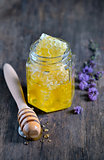 honeycomb and honey in glass jars