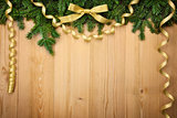 Christmas background with firtree, bow and ribbons on wood