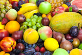 Mix of organic fruits - background