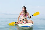 mother and son sitting on a paddle board