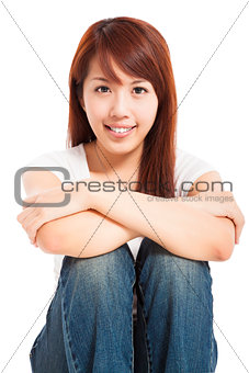 attractive beautiful young woman sitting on the floor