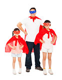 Father and daughters wearing superhero suit. isolated on white
