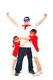 superhero daughters hug father waist. isolated on white
