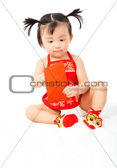 little baby girl holding a red envelope for chinese new year
