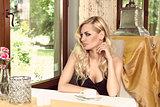girl in vintage cafe looking window