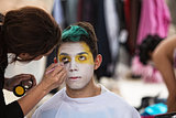 Makeup Artist Paining Clown Face