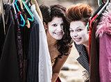 Clowns Peeking from Clothes Rack