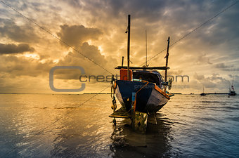 Fishing sea boat and Sunrise