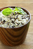 mix of wild black and white rice in a wooden bowl