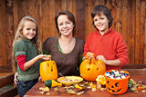 Happy family preparing for Halloween