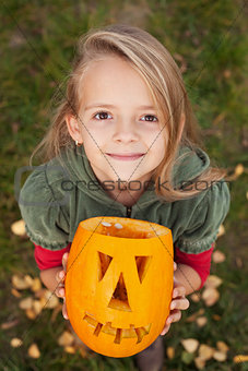 Autumn portrait with a Halloween pumpkin jack-o-lantern