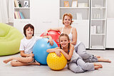 Woman and kids ready for gymnastic - sitting on the floor