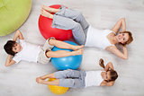 Abdominal workout - woman and kids doing gymnastic exercises